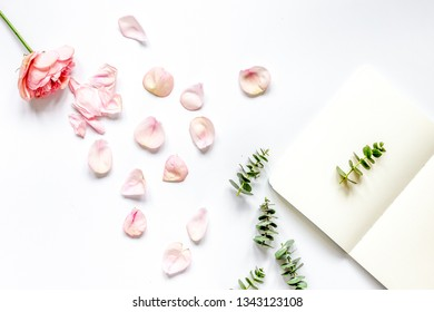 trandy design with flower and copybook on white background top veiw