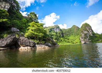 Trang An, Tam Coc, Ninh Binh, Viet nam. It's is UNESCO World Heritage Site, renowned for its boat cave tours. It's Halong Bay on land of Vietnam