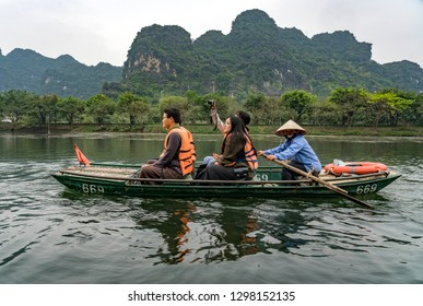 Trang An, Vietnam - January 4, 2019: Unidentified people riding raw boot in a cave in Trang An at Ninh Binh province, Vietnam.
