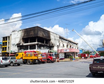 TRANG, THAILAND - AUGUST 12, 2016 : after fire Lee mart supermarket , fireman hydrant water to building, fire smoke on sky