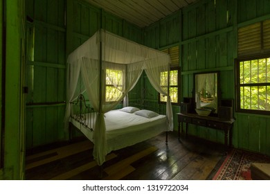 Trang, Thailand - January 1,2019 : Bedroom interior view of Phraya Ratsadanupradit Mahison Phakdi Museum in Trang, Thailand on January 1,2019.