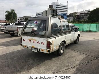 TRANG, THAILAND - JULY 8 2017: white Nissan 720 pickup car while parking