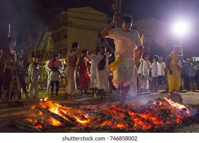 Trang, Thailand - November 1, 2017: People firewalk cross Holy bonfireat Tai-sia-hood-jow Trang Shrine located in Muang Distric.