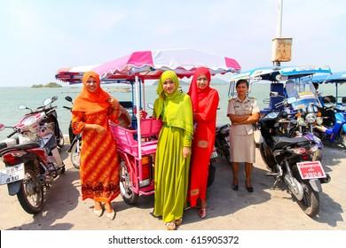 Trang, Thailand - November 24, 2016: Muslim Female wear Hijab and dress in colorful at koh sukorn in palian distric of Trang, Thailand.