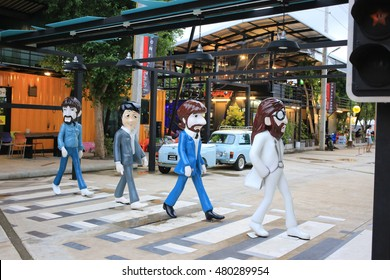 Trang, Thailand - September 5, 2016: The Beatles Abbey Road zebra crossing fiberglass statue at Cinta Garden. The container style walking street market. The Beatles were an English rock band in 1960.
