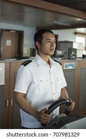 Traniee Navigation Officer Doing Hand Steering