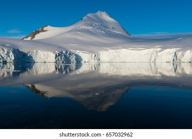 Tranquil bay in Antarctica and mirrorlike reflection