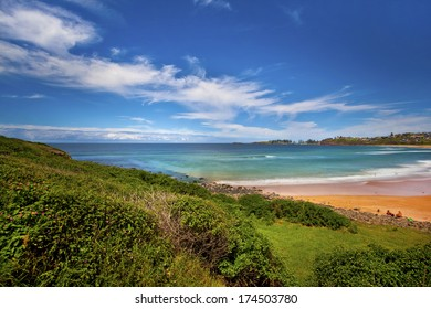 tranquil beach scene against blue sky