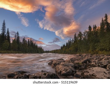 Tranquil and calm river sunset with beautiful orange clouds, Sweden
