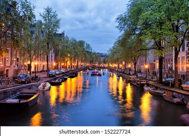 Tranquil evening by the canal in the city of Amsterdam, Netherlands, North Holland.