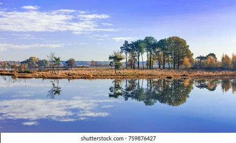 Tranquil fens with clouds reflected in the water, Turnhout, Belgium
