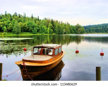 Tranquil Finnish landscape: single boat in a calm lake