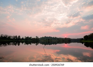 Tranquil lake and cloudy sky in sunset time