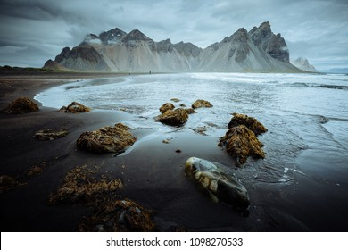 Tranquil landscape of the volcanic beach. Location Stokksnes cape, Vestrahorn (Batman Mount), Iceland, Europe. Scenic image of tourist attraction. Travel destination. Discover the beauty of earth.