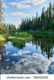 Tranquil late afternoon at the trailhead to the hiking trail to Grey Owl's cabin at the mouth of Waskesiu lake in Prince Albert National Park in Saskatchewan, Canada.