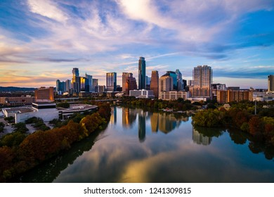 Tranquil mirrored reflections of a perfect sunset above Town Lake in Austin , Texas , USA skyline cityscape landscape perfect capital city beauty