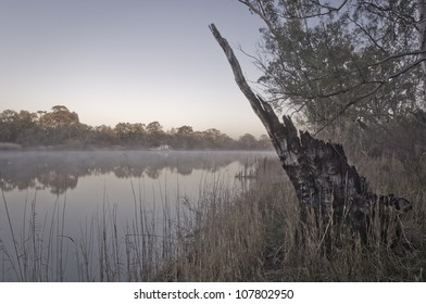 Tranquil morning river scene with mist over the water
