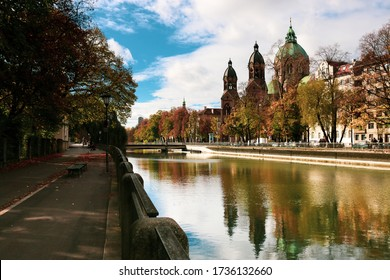 The tranquil and reflective waters of Isar river flowing through the city of Munich in the south of Germany