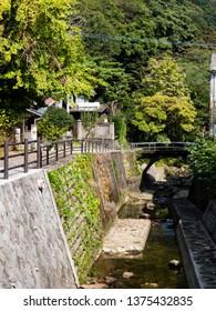 Tranquil riverside walkway in the town of Arita, Saga prefecture, Japan