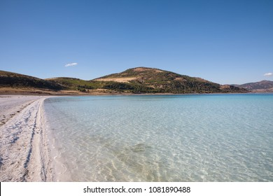 tranquil scene with calm lake and white sand, salda golu, turkey