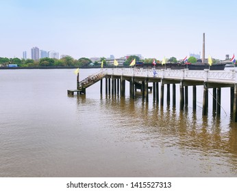 Tranquil Scenery of Pedestrian Walkway and Staircase at the Pier