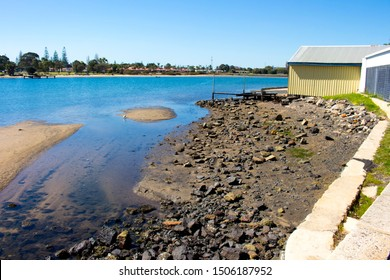 A  tranquil scenic view of the landscape at the shallow end of the Leschenault Estuary   park near Bunbury Western Australia on a calm sunny day in late spring as the tide is ebbing out.