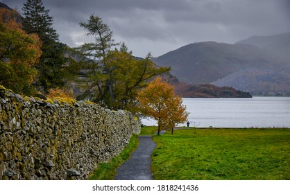 A tranquil and serene landscape on the banks of Ullwater Lake in Cumbria, England