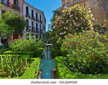 Tranquil small park on Cister street near the Ð¡athedral of  Malaga.  Andalusia, Spain.