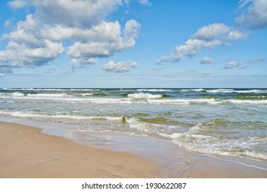 Tranquil summer scene of Baltic sea. Beautiful blue sky with cumulous cloud.