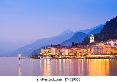 Tranquil sunset and evening illuminations of the beautiful town of Bellagio on Lake Como in Italy.