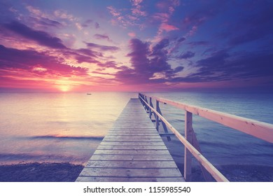 tranquil sunset - jetty in the evening light on the beach