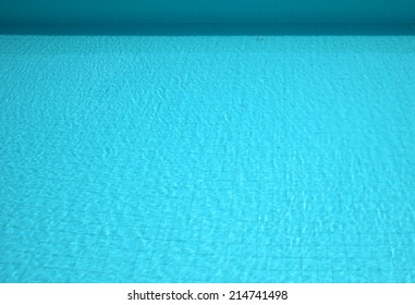 tranquil swimming pool background with blue water and a shade from the poolside at top, showing it is a sunny day