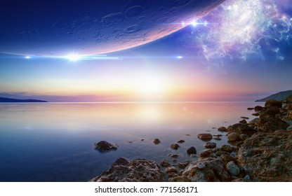 Tranquil wallpaper for ambient and chillout music, beautiful glowing sunset above serene sea, planet and glowing spiral galaxy in dark blue sky. Elements of this image furnished by NASA