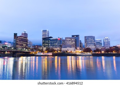 tranquil water,cityscape and skyline of portland in blue sky