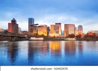 tranquil water,cityscape and skyline of portland at sunrise