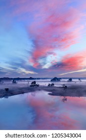 Tranquil wet land at a colorful daybreak with dramatic clouds, Turnhout, Belgium