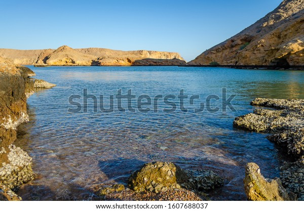 tranquilizing-view-rocky-beach-muscat-60