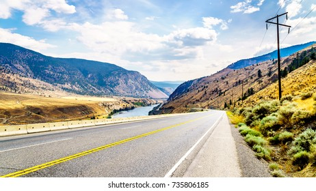 The Trans Canada Highway winding through the mountains and along the Thompson River between the towns of Cache Creek and Spences Bridge in central British Columbia