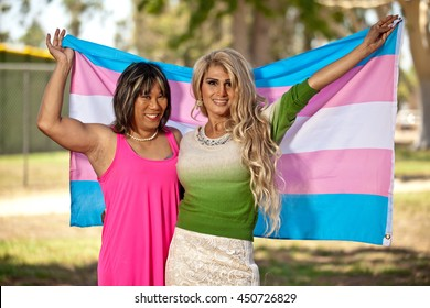 Trans gender girls holding Transgender flag