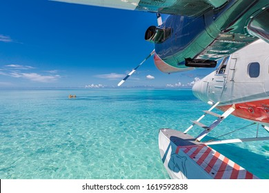 Trans Maldivian Airways Twin Otter seaplanes at Male airport. Exotic scene with Trans Maldivian Airways seaplane on Maldives sea landing. Vacation or holiday in Maldives summer vacation