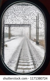 Trans Siberian Express, Siberia, Russia - March 18, 2014: Snowy rail view from Trans Siberian Express' window, Siberia, Russia.