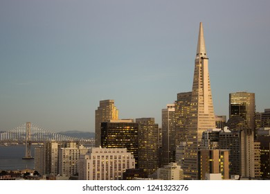 The Transamerica Pyramid and Bay Bridge at dusk on clear evening from Russian Hill, San Francisco, California, USA, 11/17/2016.