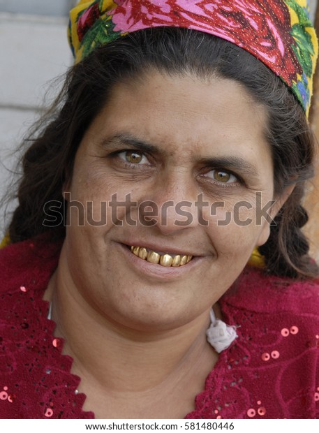 Transcarpathia, Ukraine, AUG 08, 2007: A woman of the Roma community smiles with her gold-encrusted teeth in the village of Pidvynogradiv in Transcarpathia, Ukraine.