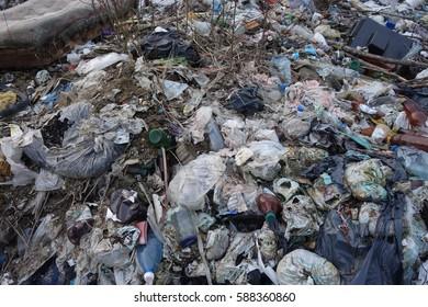 Transcarpathia, Ukraine - February 26, 2017: Contamination of the environment by humans. Garbage dump.