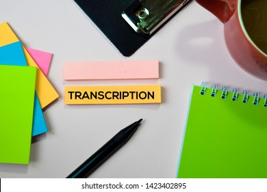 Transcription text on sticky notes with office desk concept