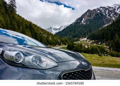 Transfagaras Highway, Romania - May 14, 2019: Kia Sportage on a background of snow-capped mountains.