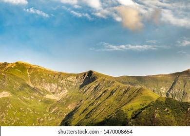 Transfagarasan mountain top under a blue sky