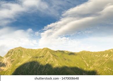 Transfagarasan mountain under a blue sky with storm clouds