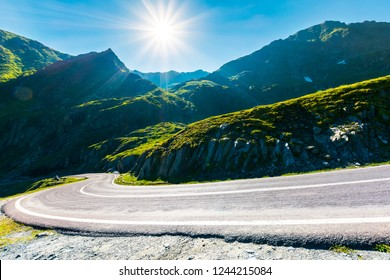Transfagarasan road in mountains winding uphill. popular travel destination of Romania. beautiful summertime weather