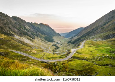 The Transfagarasan road on the Carpathian Mountains of Romania early in the morning. Transfagarasan is a paved mountain road crossing the southern section of the Carpathian Mountains.